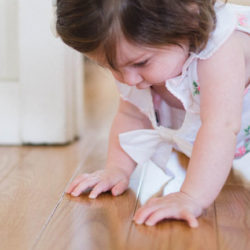 a toddler crawling on timber floors